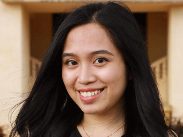 smiling headshot of Darlene Ferrer