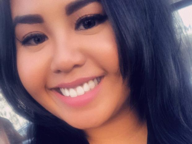 smiling headshot of Raquel Racelis
