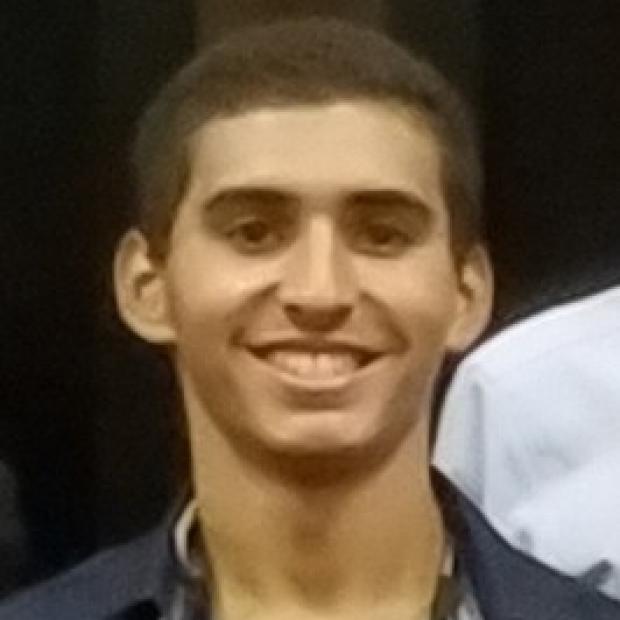 smiling headshot of Jose Acosta-Julbe