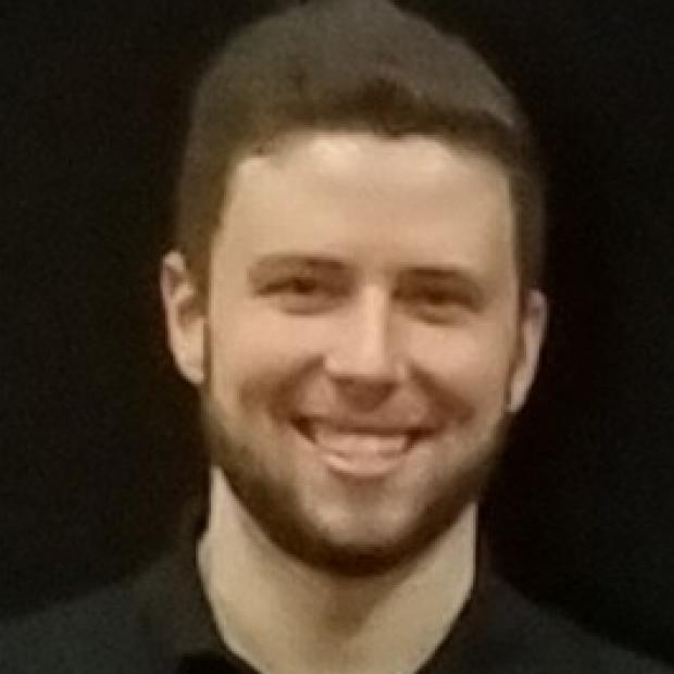 smiling headshot of Tyler Muser
