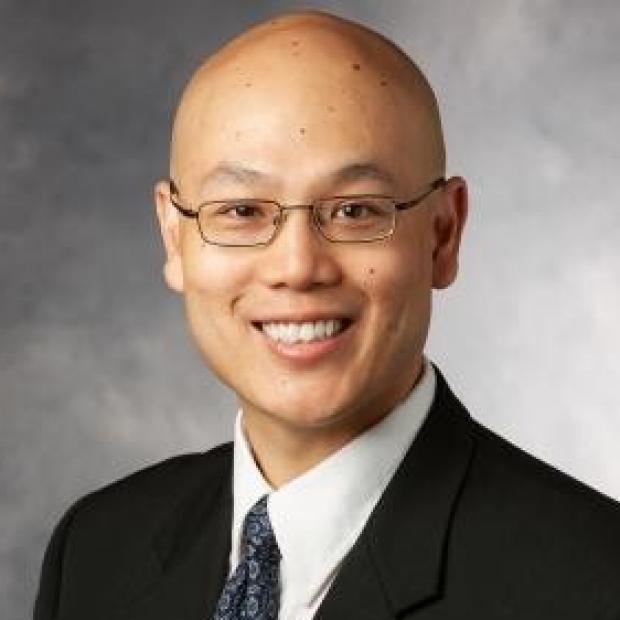 smiling headshot of Anson Lee