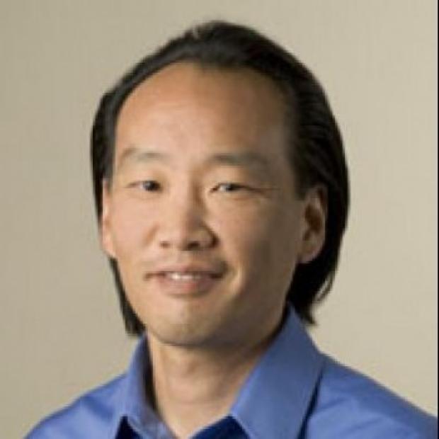 smiling headshot of Yasuhiro Shudo