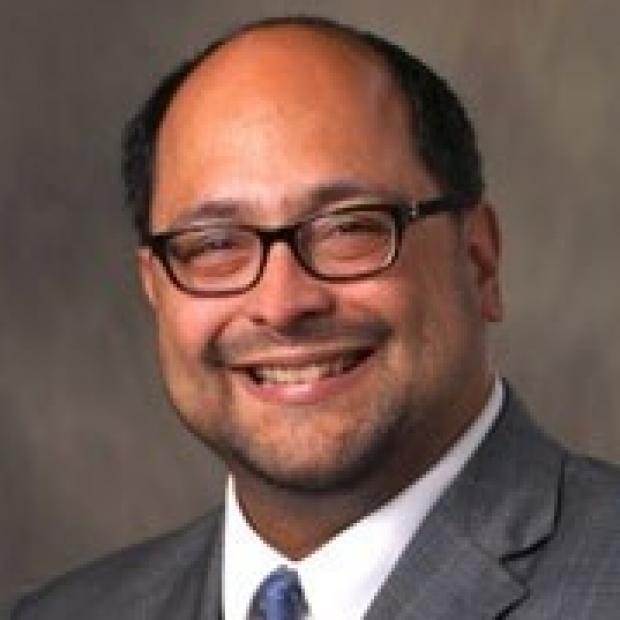 smiling headshot of Vinicio de Jesus Perez