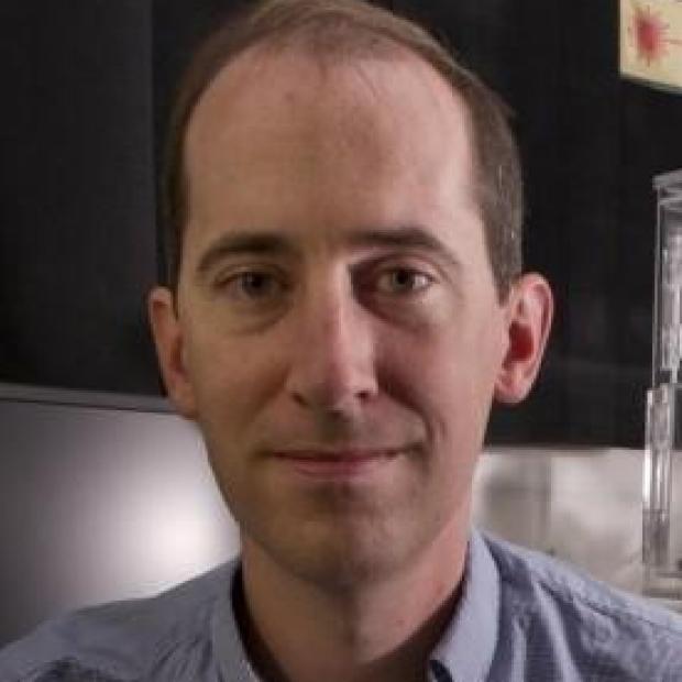 smiling headshot of Alexander Dunn
