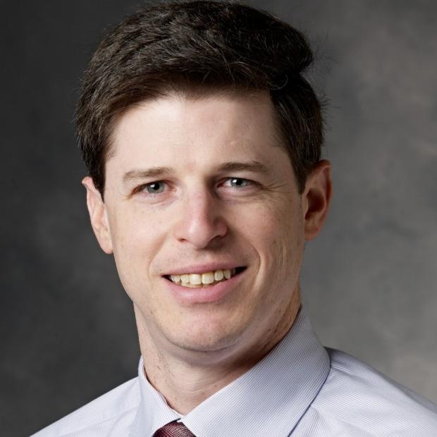 smiling headshot of Kevin Wang