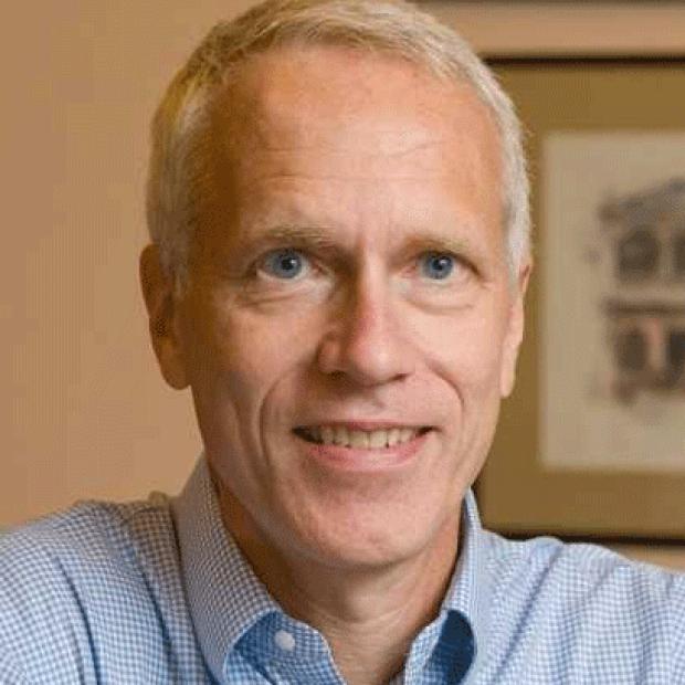 smiling headshot of Brian Kobilka