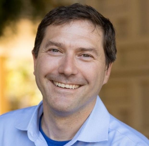 smiling headshot of Eric Gross