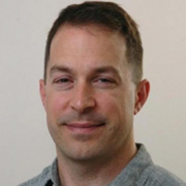 smiling headshot of Craig Levin