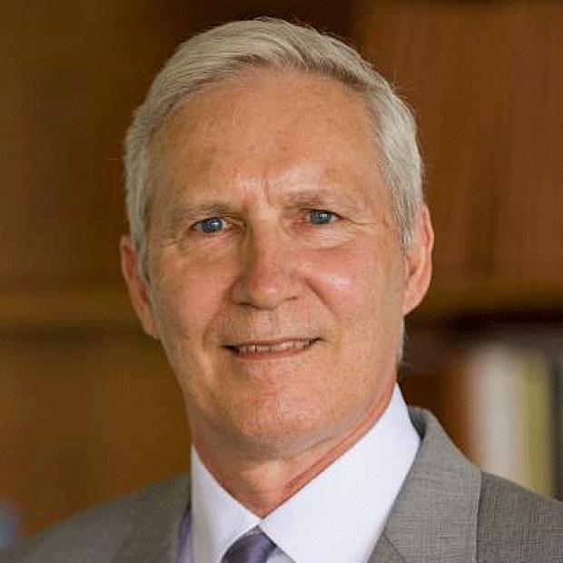 smiling headshot of John Schiller, PhD