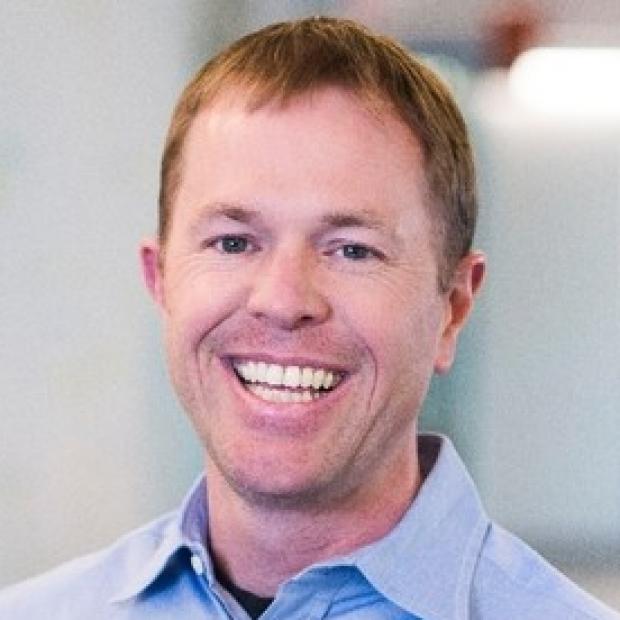 smiling headshot of Ken Mills