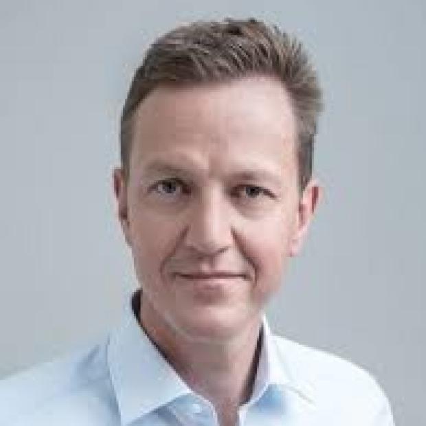 smiling headshot of Jürgen Eckhardt