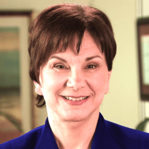 smiling headshot of Janet Woodcock