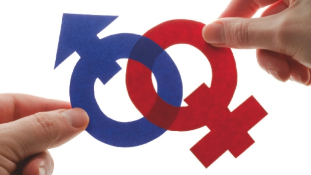 hands holding male and female symbols