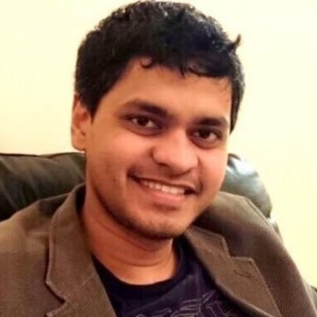 headshot of Dilip Thomas