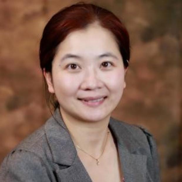 smiling head shot of Ke Yuan, PhD, FAHA