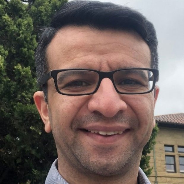 smiling headshot of Hesam Movassagh