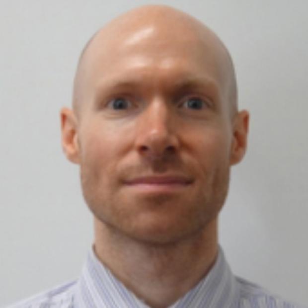 smiling headshot of William Goodyer, MD, PhD