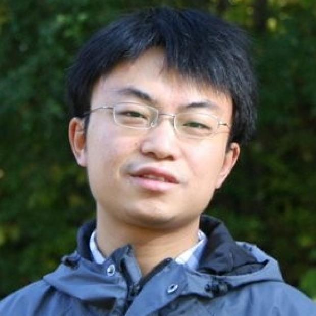 smiling head shot of Qing Liu, PhD