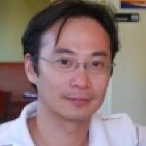smiling head shot of Kwang-Min Kim, PhD