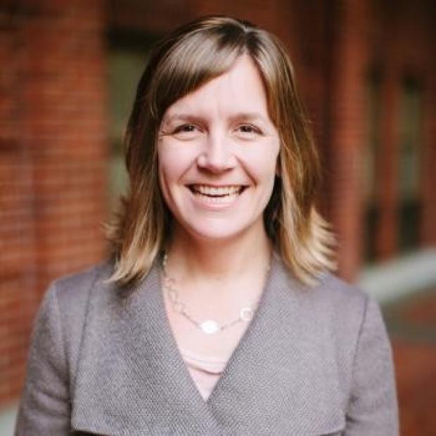 smiling headshot of Michelle C. Odden, PhD