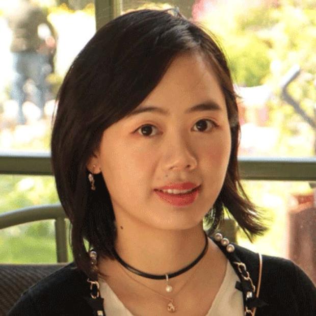 smiling headshot of Xiaoming Ouyang, PhD