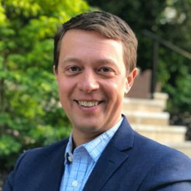 smiling headshot of Dr. Erik Ingelsson