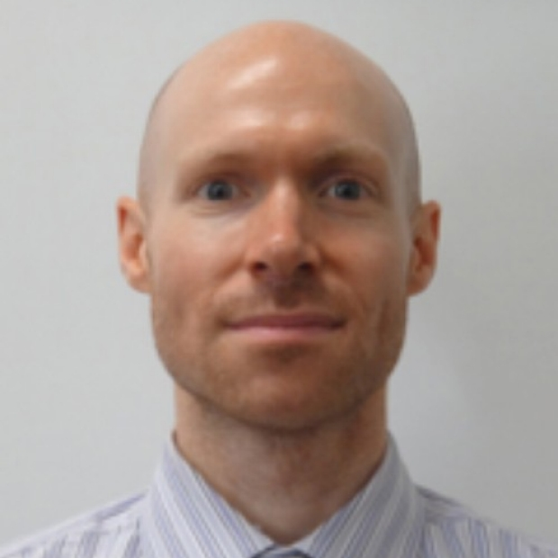 smiling headshot of Dr. William Goodyer