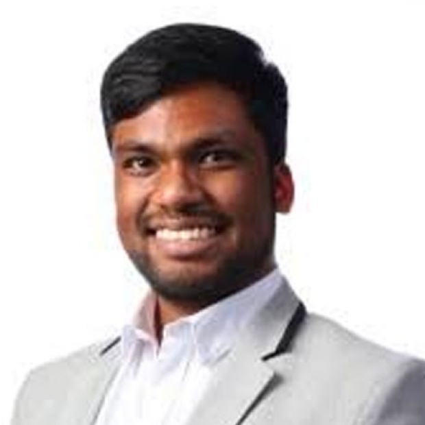 smiling headshot of Anojan Selvalingam