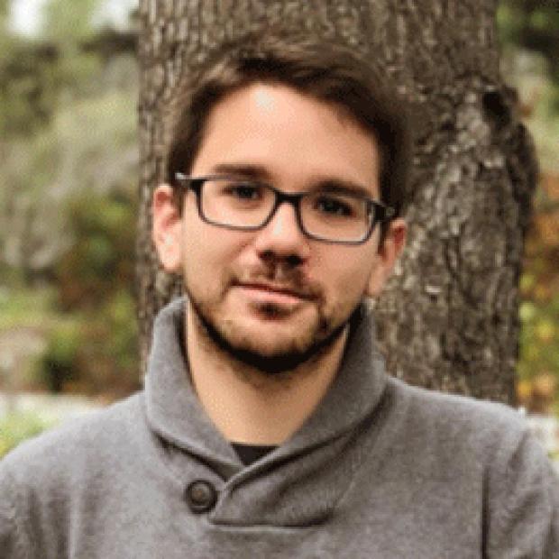 headshot of Isaac Perea-Gil