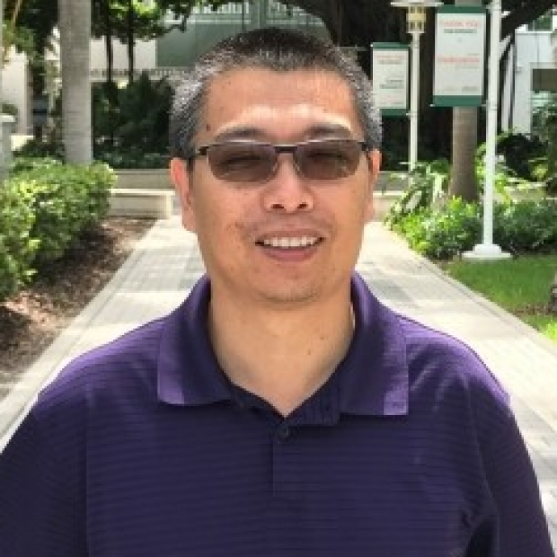 smiling headshot of Jinliang Li