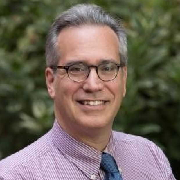 smiling headshot of Michael Kapiloff