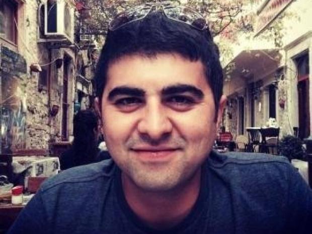 headshot of Mehmet Ozen