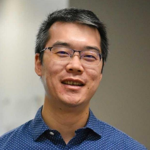smiling headshot of Huxiao Yang