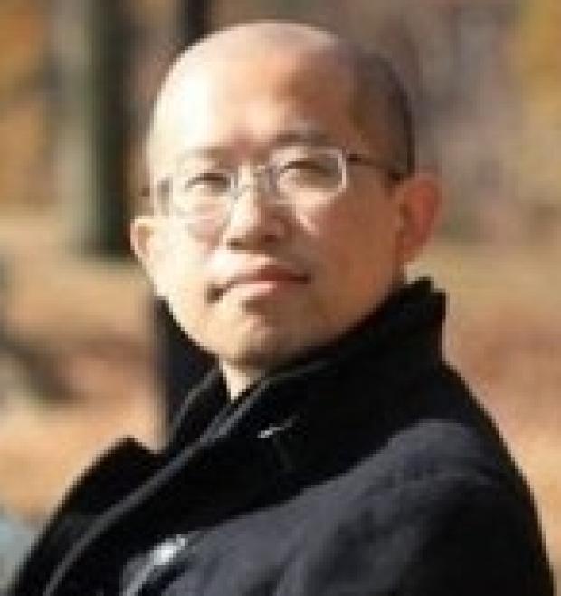 smiling headshot of Ningyi Shao