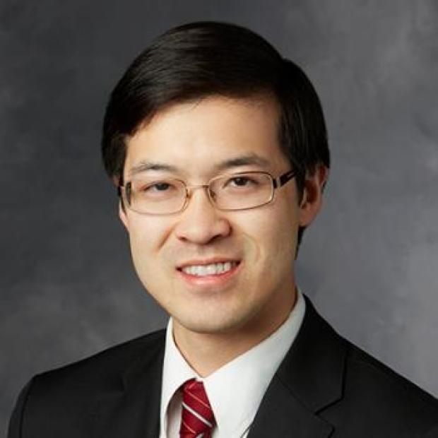 smiling headshot of Dr. Hanjay Wang
