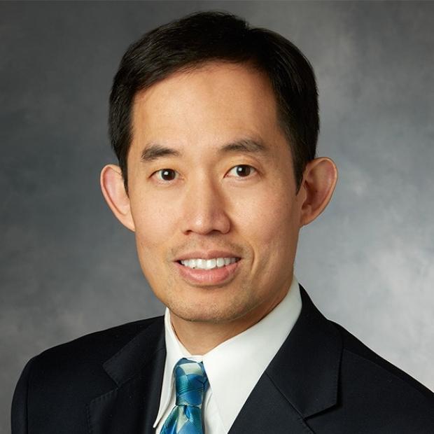 smiling headshot of Dr. Joseph Woo