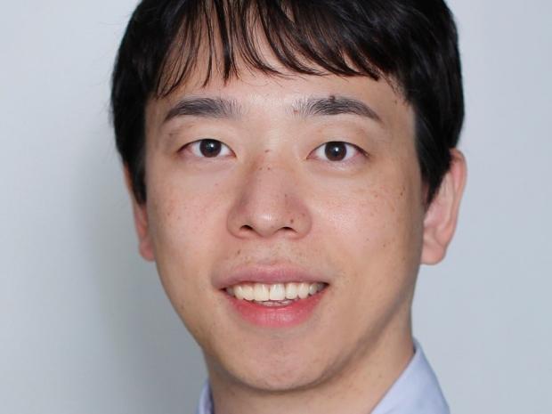 smiling headshot of Dr. Tomoya Kitani