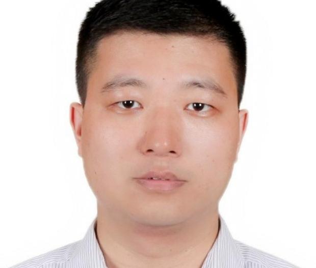 headshot of Tiejun Zhang