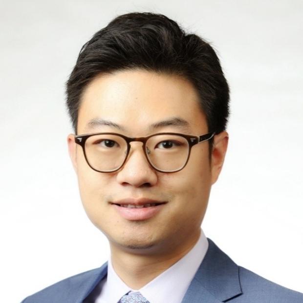 smiling headshot of David Paik
