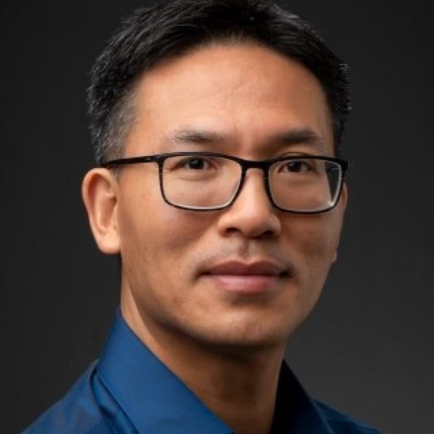 smiling headshot of Xinguo Jiang