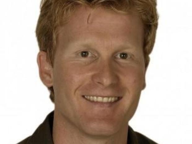 smiling headshot of Lars Steinmetz
