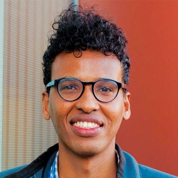 smiling headshot of Mohamed Ameen