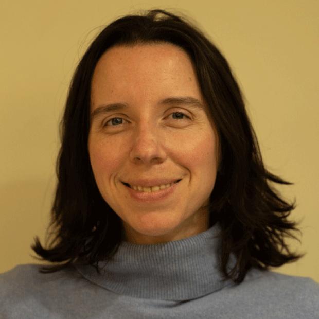 smiling headshot of Adrienne Mueller