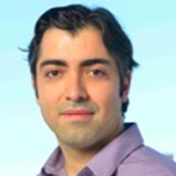 smiling headshot of Amin Arbabian