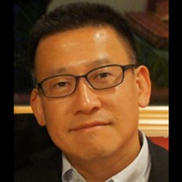 smiling headshot of Phillip Yang