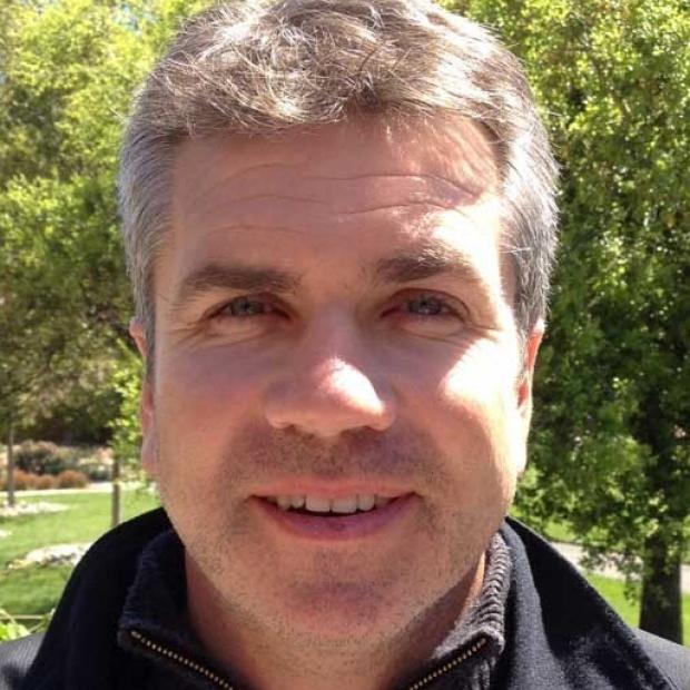 smiling headshot of Ed Finn