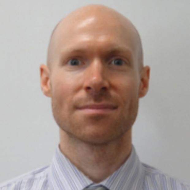 smiling headshot of William Goodyer