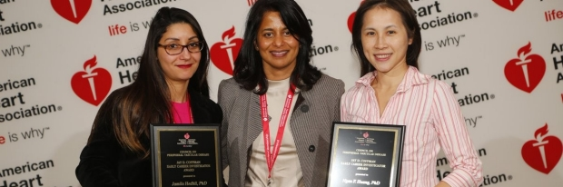 three women, two holding awards