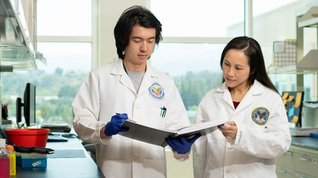 Alex Chan and Ngan Huang in a lab