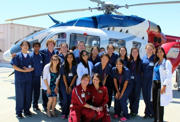 Group photo in front of Life Flight helicopter